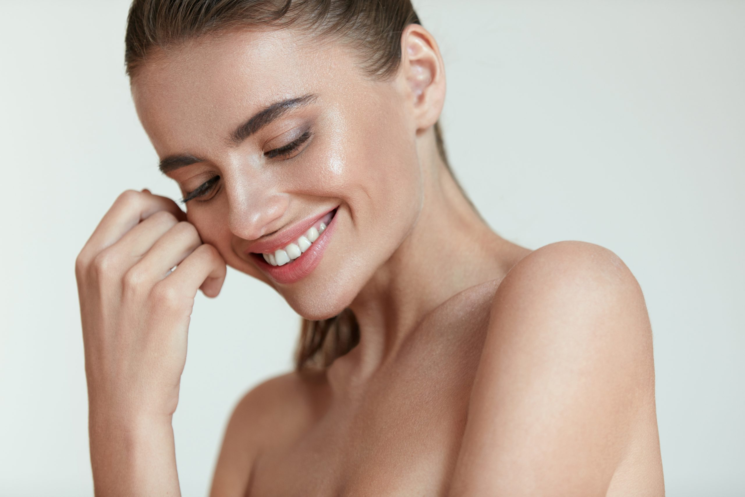 woman smiling while looking downwards