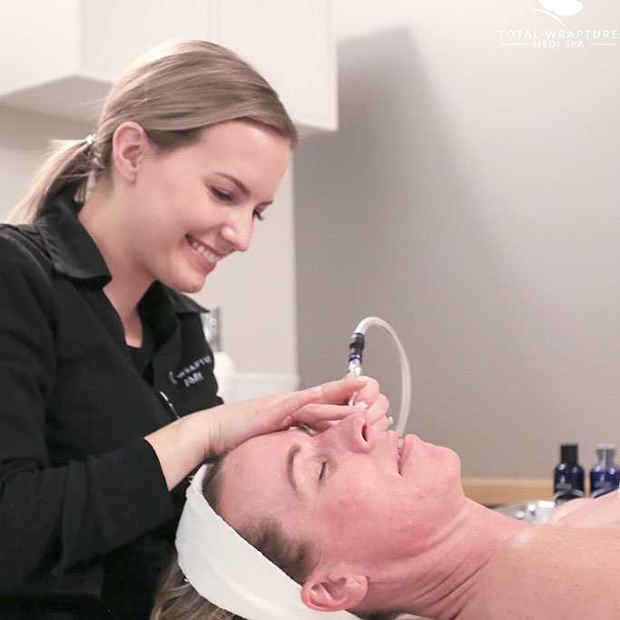 esthetician performing microdermabraison treatment