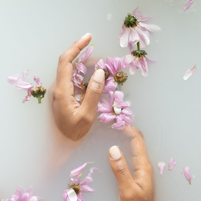 neutral manicured nails and flowers