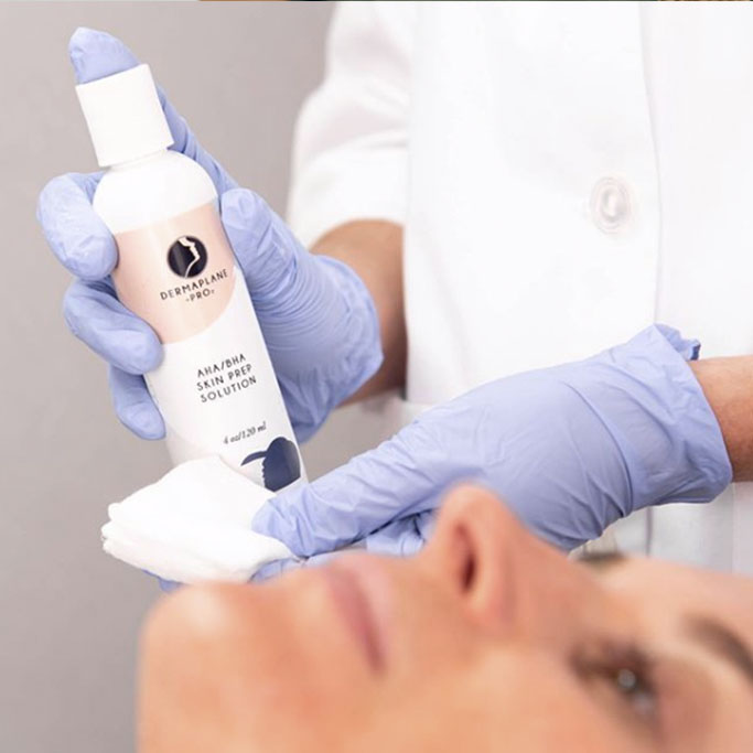 person holding dermaplane product